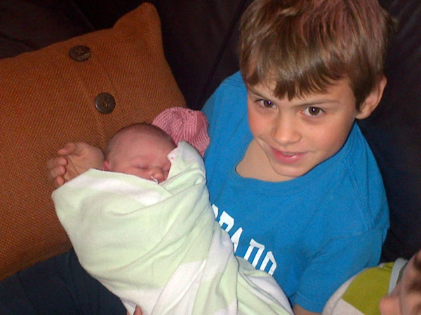 Andrew Holding Lucia