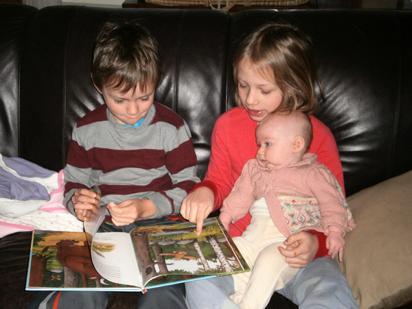 Elliot & Mari Reading to Lucia