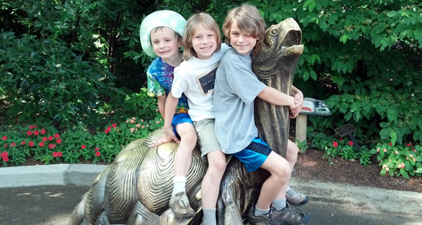 The Three Big Kids Riding a Giant Turtle