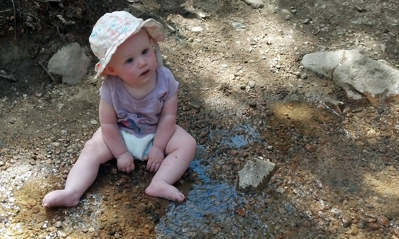 Lucia Playing in the Creek