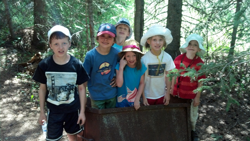 The Kids in an Old Mine Cart