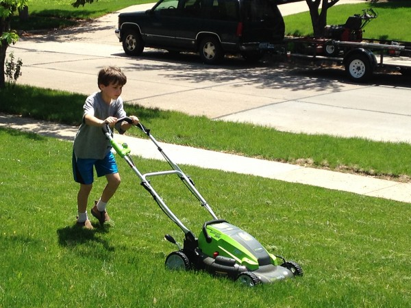 Andrew Mowing the Lawn