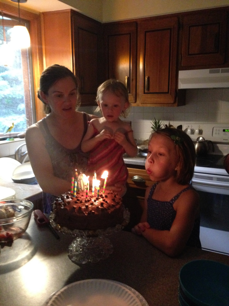 Mari blowing out her candles