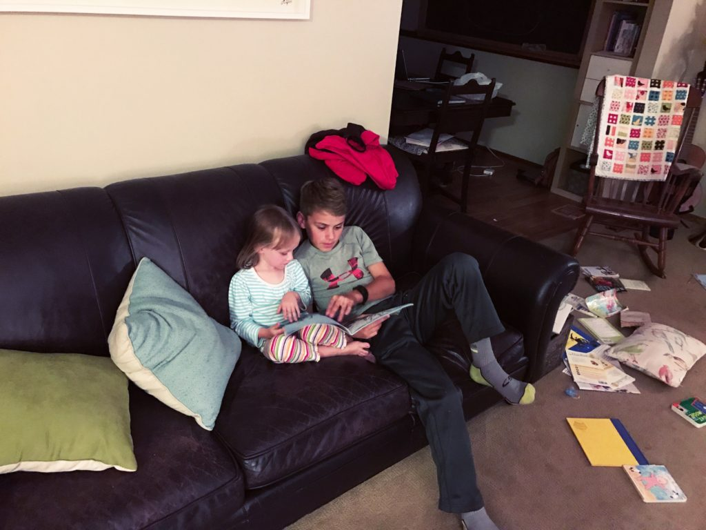 Andrew (just 13) reading to Lucia (4, tomorrow).